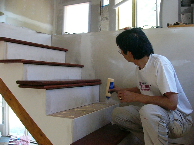 August 22, 2010: Russell Uses Wood Glue To Attached The Finished Treads To  The Rough Stairs.